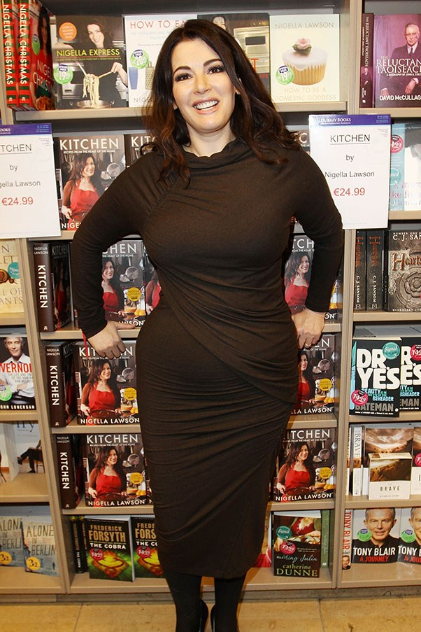 A black, gathered jersey frock flatters Lawson's curves at a book signing in 2010.