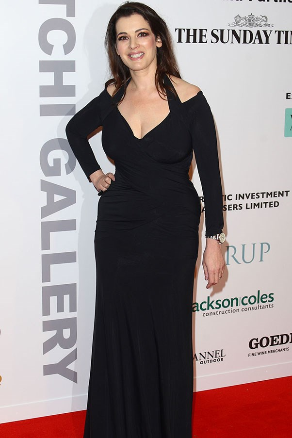 """Nigella dons a long, black gown with cutaway shoulders for a Saatchi Gallery launch party in 2008. <br><br>MORE NEWS: <a href=""""http://www.elle.com.au/news/fashion-news/2013/12/erin-wasson-walks-at-chanels-métiers-dart-show-in-dallas/"""">Erin Wasson walks at Chanel's Métiers d'Art show in Dallas</a><BR><br> <a href=""""http://www.elle.com.au/news/fashion-news/2013/12/chanel-pre-autumnwinter-2014-15/"""">Chanel Pre Autumn/Winter 2014-15</a><BR><br> <a href=""""http://www.elle.com.au/news/fashion-news/2013/12/the-ultimate-christmas-gift-guide/"""">ELLE's Christmas Gift Guide</a>"""