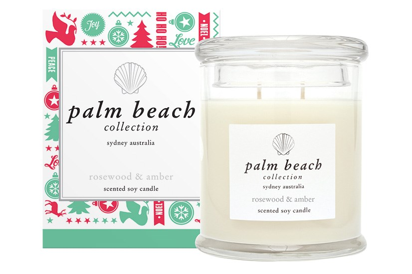 """Instantly conjuring Christmas cheer, the Palm Beach Collection Rosewood & Amber candle ($37.95, <a href=""""http://palmbeachcollection.com.au"""">palmbeachcollection.com.au</a>) is a must have."""