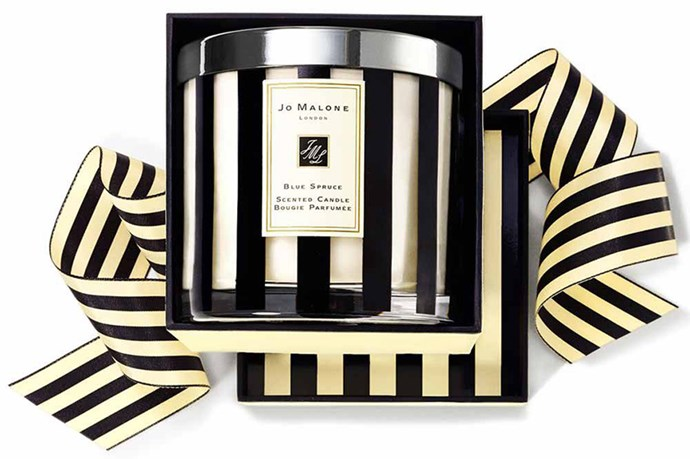 """Cinnamon, patchouli and golden amber are the dreamy scents in Jo Malone's limited edition Blue Spruce Deluxe Candle ($315, <a href=""""http://jomalone.com.au"""">jomalone.com.au</a>) for this Christmas' festivities."""