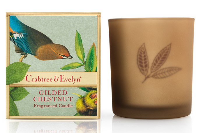 """Chestnuts roasting on an open fire, Jack Frost nipping on your nose, Yuletide carols being sung by a choir, and folks dressed up like Eskimos.  Not in Australia they aren't, but chestnuts we do have. Try the Gilded Chestnut Large Poured Candle (from $20, Crabtree & Evelyn,<a href=""""http://crabtree-evelyn.com.au""""> crabtree-evelyn.com.au</a>)."""