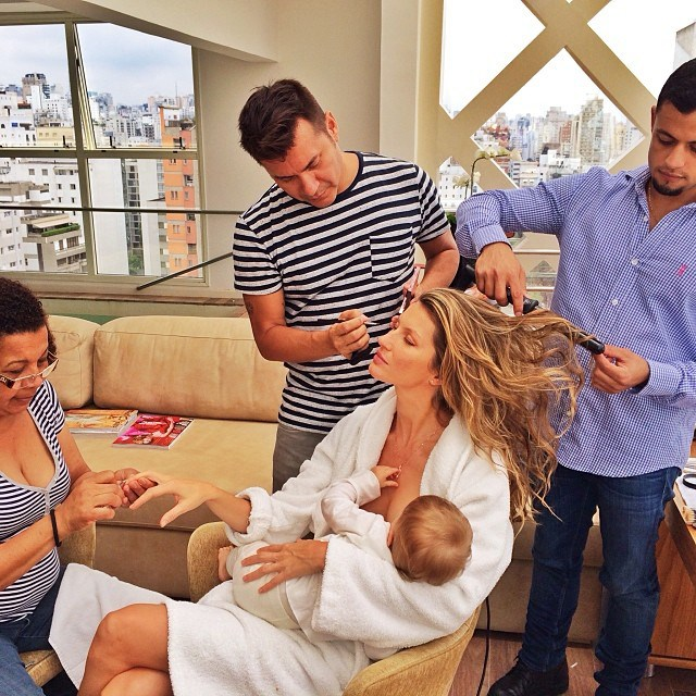 """Bündchen mocks the very definition of multi-tasking with this Instagram photo. Here she is breastfeeding her one-year-old daughter, Vivian, being preened for an event by a team of hair and makeup artists and looking like a total goddess, all simultaneously. """"What would I do without this beauty squad after the 15 hours flying and only 3 hours of sleep?"""" she said. And while she hashtagged her post 'multitasking', we doubt she was working up a sweat."""