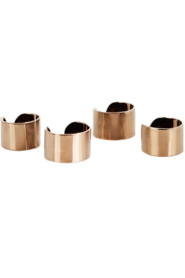 "Rings, approx $325 for set of four, Maison Martin Margiela, <a href=""http://www.net-a-porter.com"">net-a-porter.com</a>"