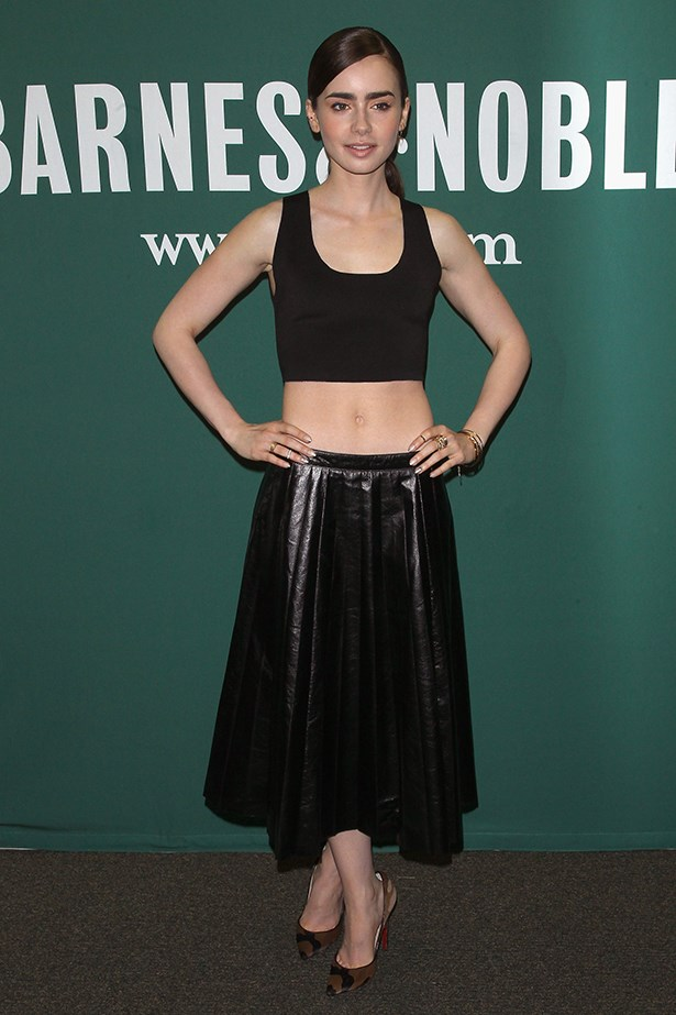 <p><strong>Most elegant display of midriff</strong></p> <p><strong>Lily Collins</strong></p> <i>Image: Wearing Céline at a Barnes & Noble event.</i>