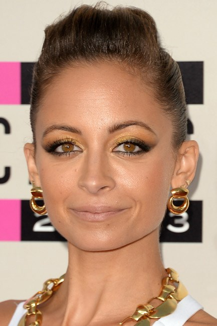 <strong>The hoopla </strong><br> Nicole Richie was a golden girl when she decorated her ears with a new kind of hoop earring. One part stud and one part loop, this solid style is, well, solid chic.
