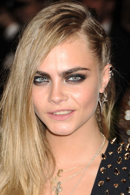 <strong>The rock chic</strong><br> Cara Delevingne rocked out at the Met Gala's punk theme by piling on ear cuffs, drop earrings and studs – all on the one ear. Not for the faint hearted pop princess.