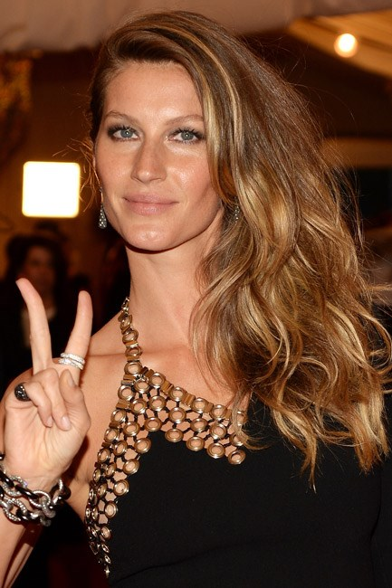 <strong>Windswept</strong><br> We repeat: the idea is windswept, <em>not</em> dishevelled. To get Gisele Bündchen's sleek style, apply a frizz ease product once your hair is dry, then lightly blow-dry and hairspray to secure the hair to one side.