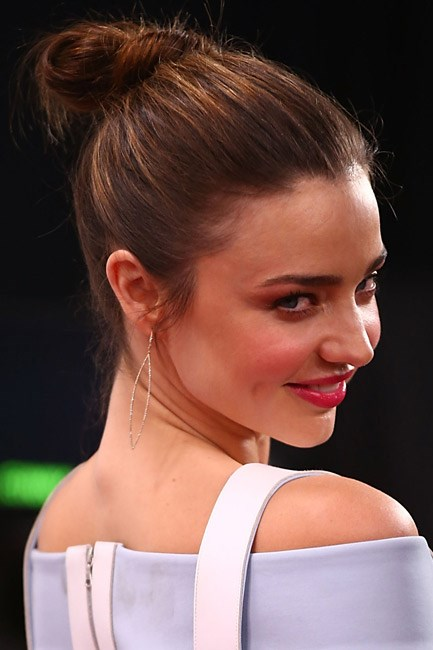 <strong>Knotted</strong><br> The high topknot is <em>so</em> last summer. This season, bring your post-swim bun down a notch – like Miranda Kerr – and fasten the loop to be aligned with the crown of the head.
