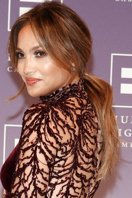 <strong>Ponytail</strong><br> The key to Jennifer Lopez's ponytail looking more glam-girl and less surfer-girl is the <em>height</em> that she's managed around the head. Work with the beachy waves you have and apply a texturising powder to the locks to give the hair body, before you secure with an elastic.