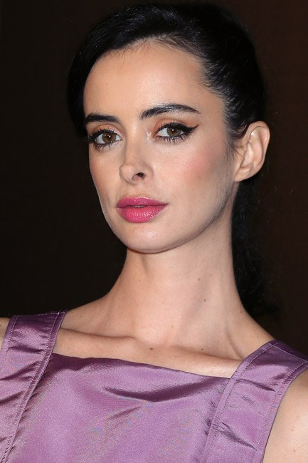 Krysten Ritter matched a Radiant Orchid blush and lip-gloss to her Katie Ermilio gown, at a Van Cleef & Arpels event.