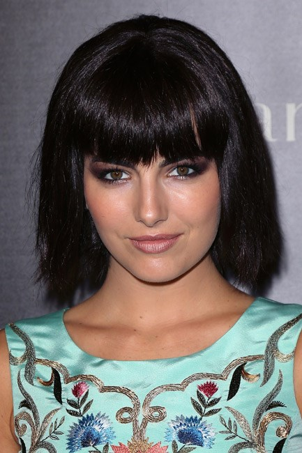 <strong>AFTER: Camilla Belle<br> Bang bang:</strong> According to, err, science, cutting a fringe is one of the most common New Year's hair resolutions. Camilla Belle went all out and scissored hers blunt and sweet.