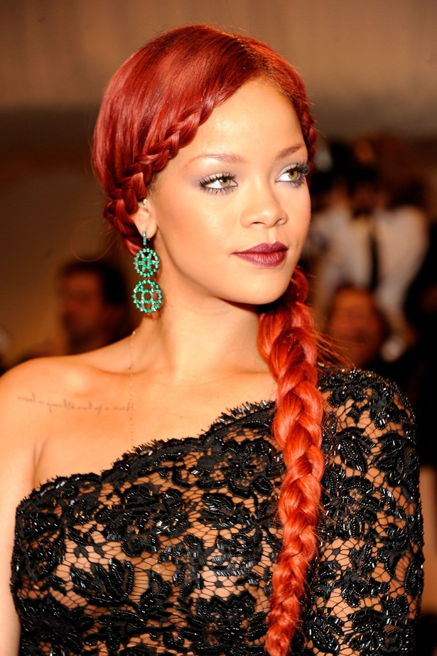 On the arrivals carpet at the 2011 'Alexander McQueen: Savage Beauty' Costume Institute Gala at The Metropolitan Museum of Art, Rihanna's Stella McCartney gown was complemented with a medieval waist length plait and maroon lipstick.