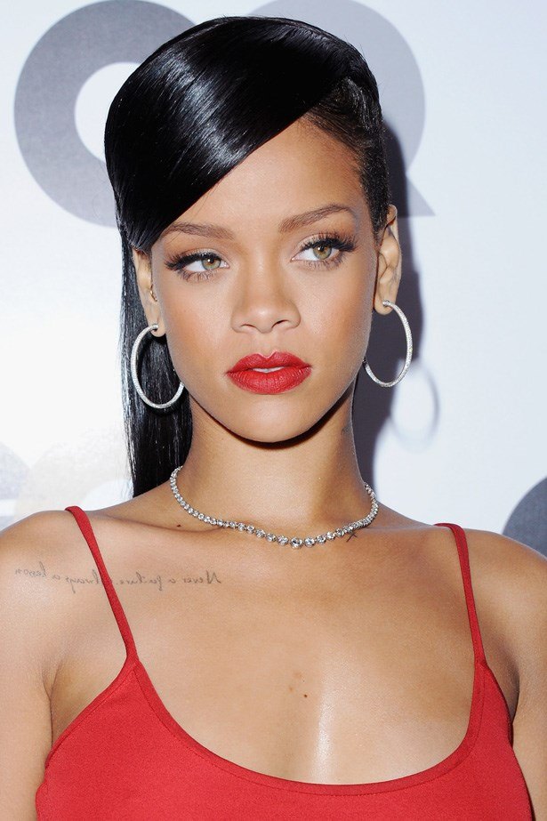 Lashes upon lashes, and red lips to match her camisole dress, Rihanna attended the GQ Man of the Year Awards in 2012.