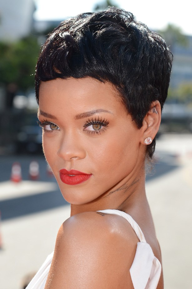 Debuting a new pixie crop, Rihanna's 'less is more' beauty look was complete with false lashes, and matte red lips.
