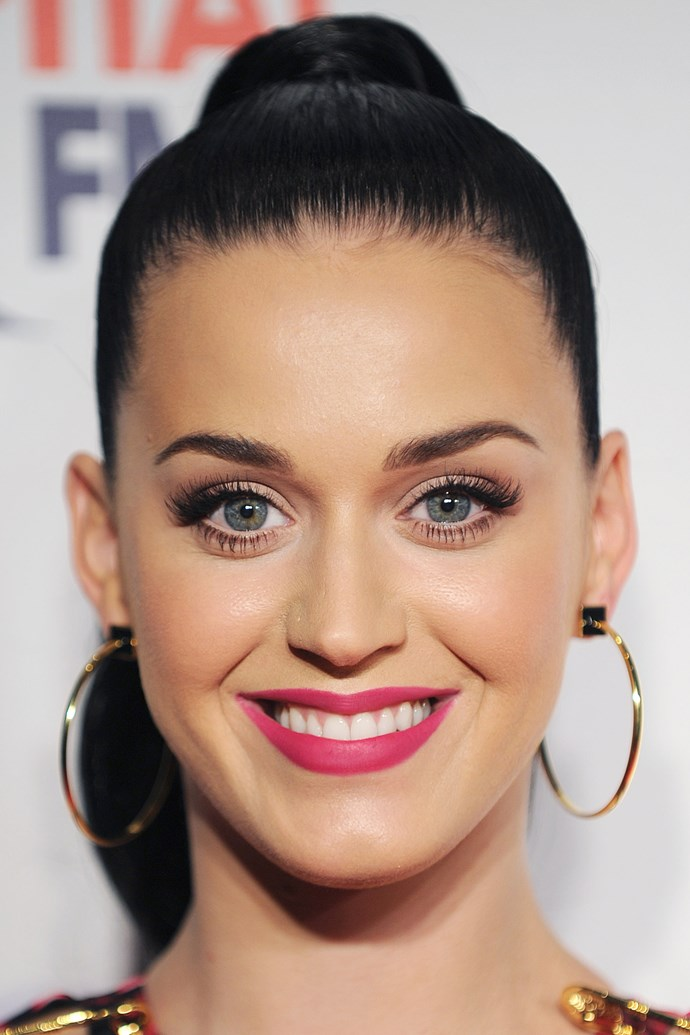 High and slick, Katy Perry's updo draws all attention to her perfect pink pout. With a little securing hair spray, this is the perfect post-beach night-out hairstyle.