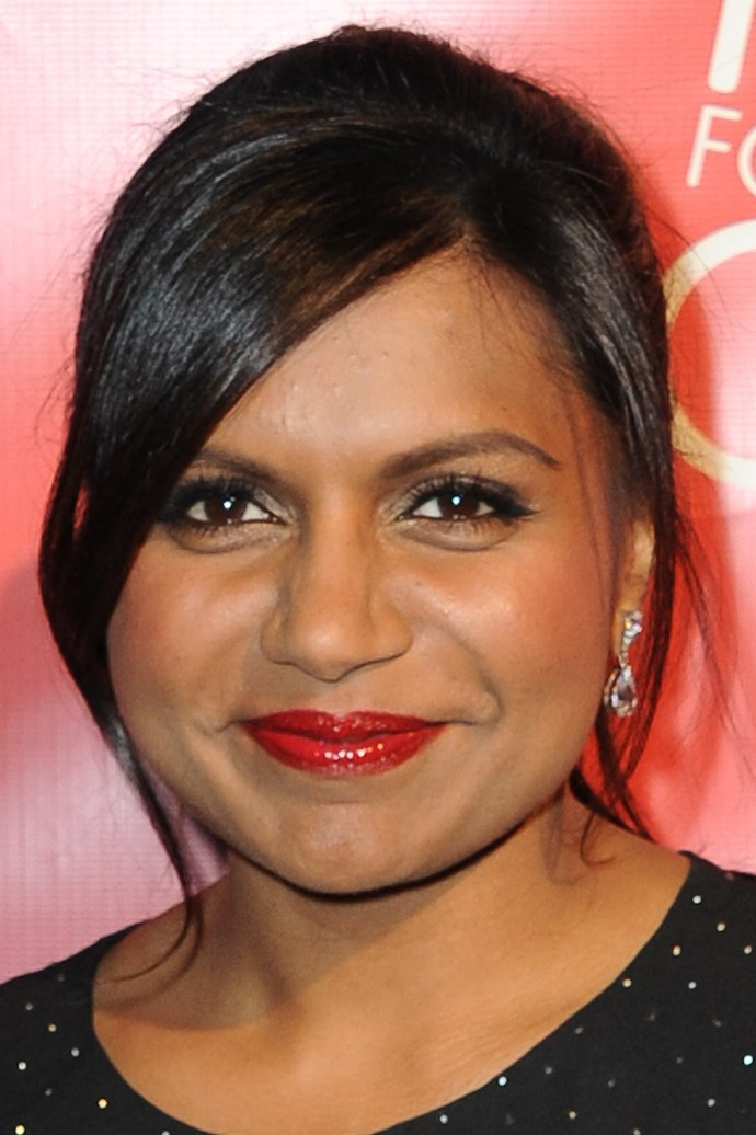 Mindy Kaling wears a side swept pony with face framing strands.  A perfect 'do for those growing out their fringe.