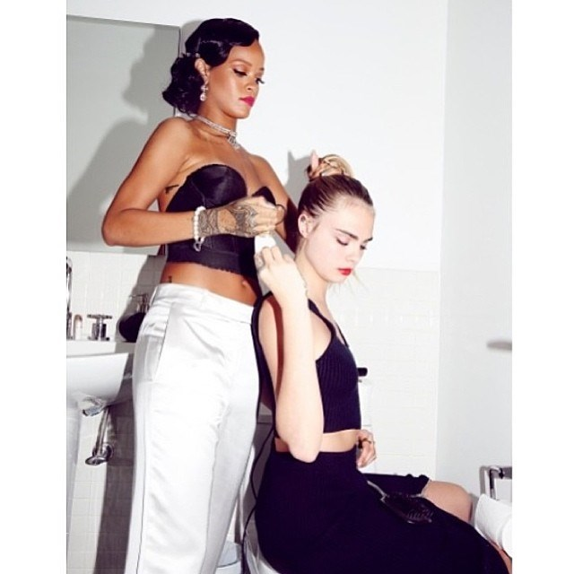 Cara Delevingne shared a behind-the-scenes snap of host Rihanna helping her get those locks party-ready (@caradelevingne).