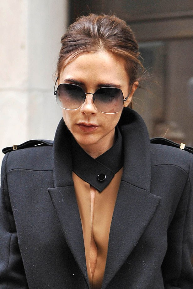 Victoria Beckham is a pioneer in the oversized sunglasses trend, here she wears her own rimless design.