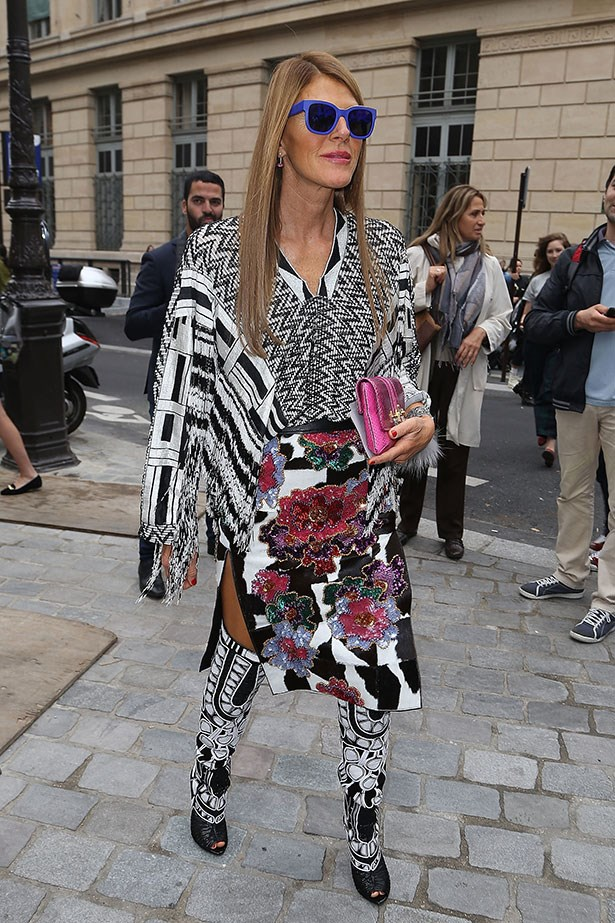 Fashion wildcard Anna Dello Russo contrasts her monochrome outfit with a pair of cobalt blue frames.