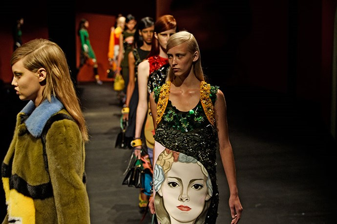"""<p>People will look, and then listen, said Miuccia Prada of her primary-coloured collection of dresses, trimmed in crystals and emblazoned with street-art portraiture. Her women were ready for action, with rubberised heels and pulled-up sports socks. It's a rebellious reinvention of the punk-rock """"riot grrrl"""" of the early '90s. If this is what modern-day feminism looks like, expect a generation of new recruits.</p> <p><strong>Prada SS14</strong></p>"""