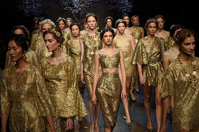 <p>The fashion force that formed the finale at Dolce & Gabbana was no less convincing, with models robed in gold and wearing prize-fighter belts at their waists. </p> <p><strong>Dolce & Gabbana SS14</strong></p>