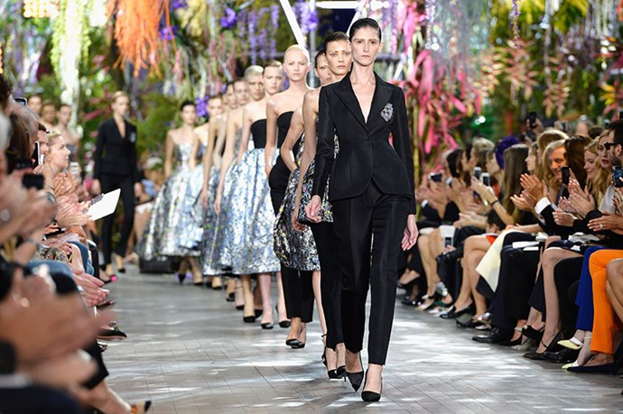 <p>At Christian Dior, Raf Simons sent out a detachment dressed in black tailoring and silver brocade, bearing shield-like badges pinned to their chests. </p> <p><strong>Dior SS14</strong></p>