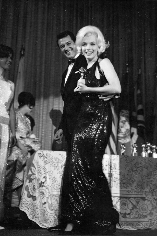 <strong>Marilyn Monroe, 1962</strong><br> Ever the show-stopper, Monroe donned an eye-catching emerald green sequinned gown by Norman Norell to accept her award.