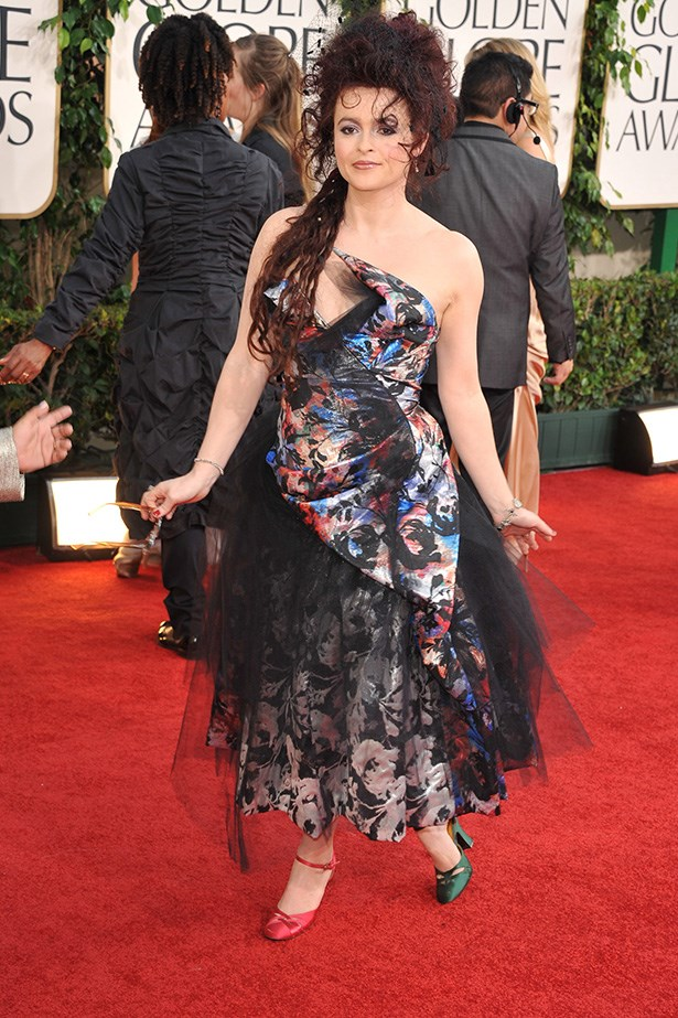 "<strong>Helena Bonham Carter, 2011<br></strong> We love this kooky English actress and her eccentric fashion choices on and off the red carpet. And her 2011 Globes selection of a Vivienne Westwood gown and mismatched shoes were no exception. Helena summed it up nicely: ""If you're going to spend three hours getting ready you may as well go for it."""