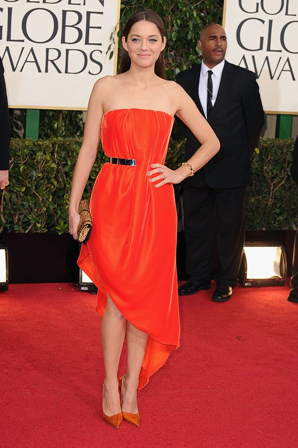 <strong>Marion Cotillard, 2013</strong><br> Cotillard likes to push the style boundaries, and this Christian Dior couture gown certainly did that. The bold orange colour, the asymmetrical hemline, the minimal accessories – it's a winner in our book.