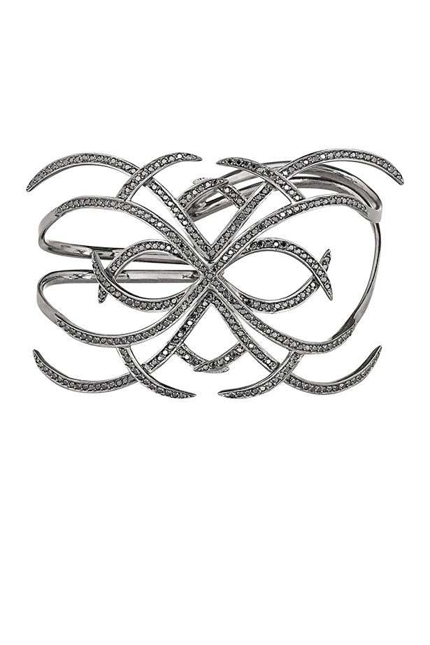 "<p>New York jeweller Ana Khouri's black diamond arachnid cuff is primed and ready to be snapped up by Madonna, already a fan.</p> <p>Hand cuff, approx $39,700, Ana Khouri, <a href=""http://www.net-a-porter.com"">net-a-porter.com</a></p>"