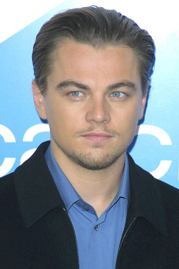 Looking suave, and sporting the shadow of a 'stache at the <em>Catch Me If You Can</em> premiere, DiCaprio's slick hair would later become his red carpet go-to look.