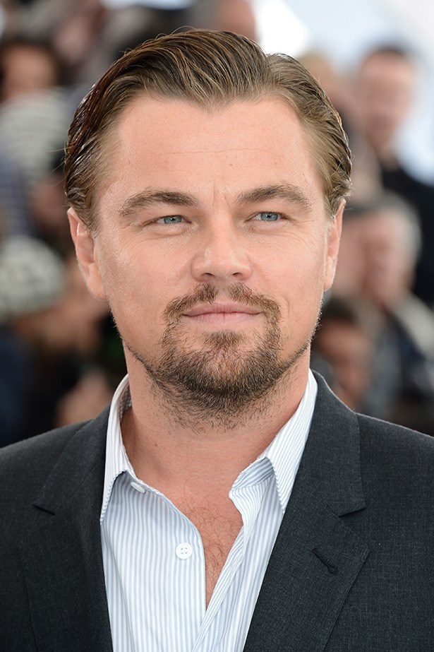 At the <em>Great Gatsby</em> photo call in 2013, the star sported thicker facial hair and well-gelled hair.