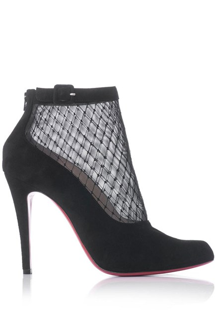 Heels, $986, Christian Louboutin, matchesfashion.com