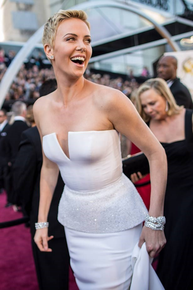 <strong>Charlize Theron</strong><br> Rocking a pixie cut like no one else can, the blonde beauty presented an award at the 2013 Academy Awards in elegant white Christian Dior Haute Couture and $4.5 million worth of Harry Winston diamonds, including those ah-mazing cuffs.