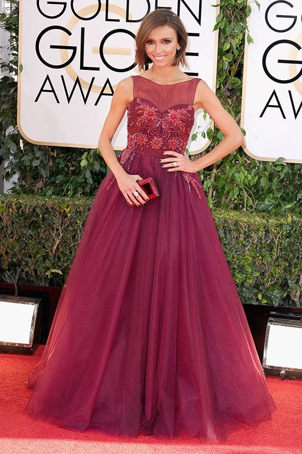 Giuliana Rancic wearing a maroon Lorena Sarbu at the 2014 Golden Globes