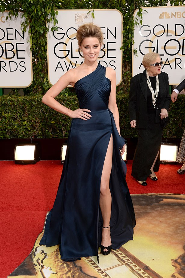 Amber Heard wearing a one-shouldered, navy Versace gown at the 2014 Golden Globes