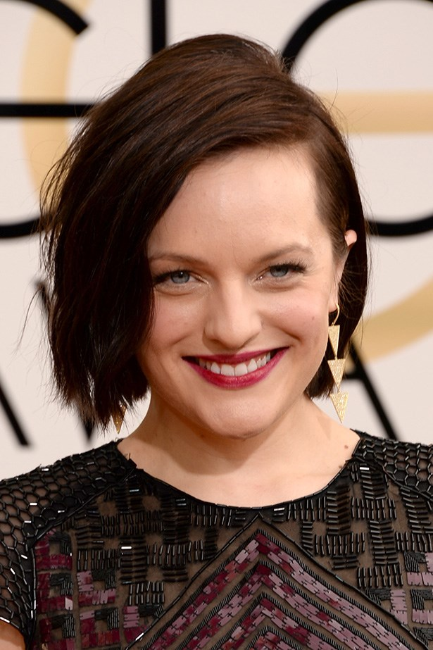 <strong>SIDE PARTS<BR></strong> Nominee Elisabeth Moss went for a modern side-part, textured bob. The perfect accompaniment to her edgy accessories.