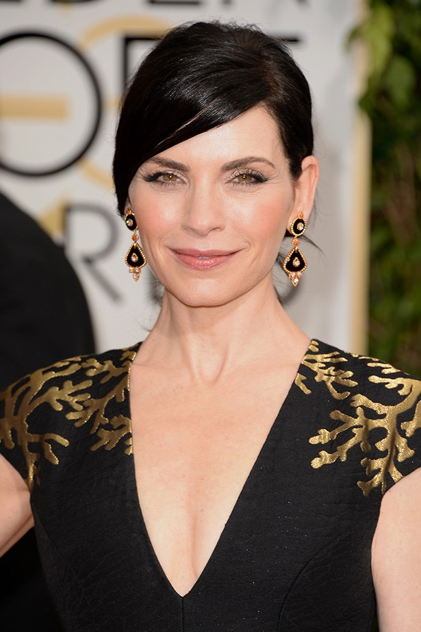 <strong>SIDE PARTS<BR></strong> Star of <em>The Good Wife</em>, and nominee, Julianna Margulies wore her jet black hair in a side parted chignon.