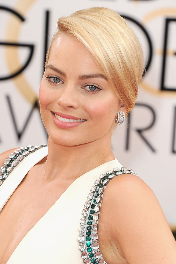 <strong>SIDE PARTS<BR></strong> A long way from Ramsay Street, Margot Robbie attends this year's Golden Globes with her flaxen hair styled in a timeless side-parted bun.