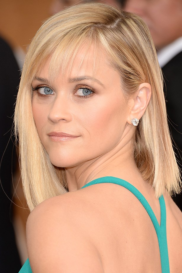 <strong>NUDE HUE<BR></strong> Reese Witherspoon glowed on the red carpet, with gold shimmer eye shadow, contouring bronzer, and a soft nude lip to finish her look.