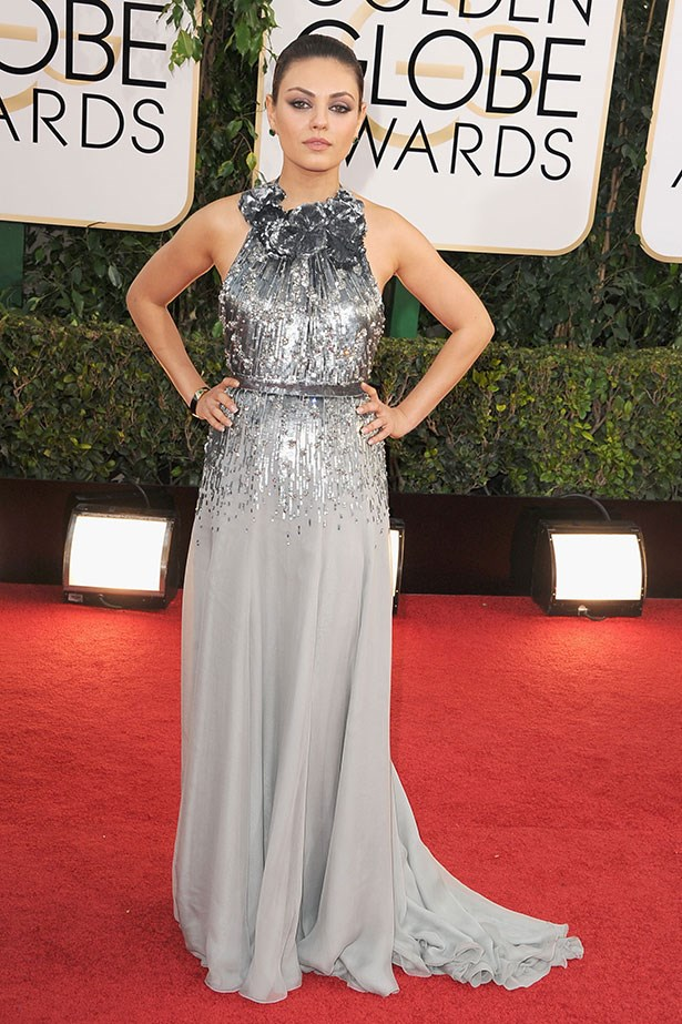 Mila Kunis turned heads on the red carpet the 2014 Golden Globes wearing a silver-sequinned and silk Gucci gown