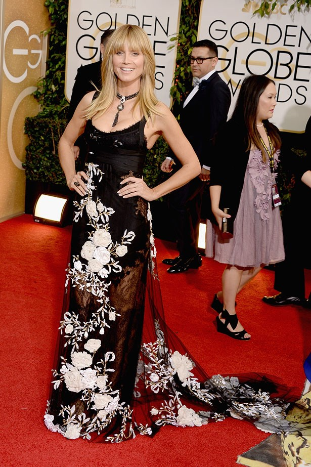 Heidi Klum wearing a black lace and floral Marchesa gown at the 2014 Golden Globes