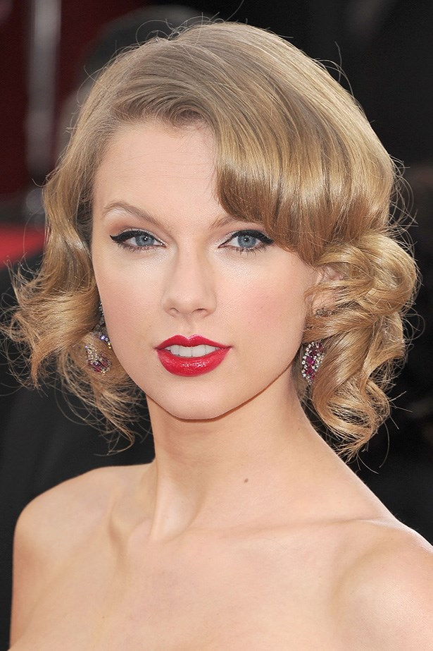 <strong>RED LIPS<BR></strong> The country belle looked like a 1950's pin-up girl with a curled up-do and red lipstick.