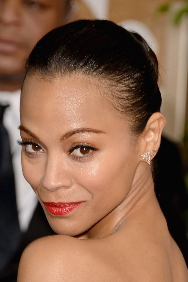 <strong>RED LIPS<BR></strong> Zoe Saldana strutted the red carpet with a ballerina bun, and burnt-red lips.