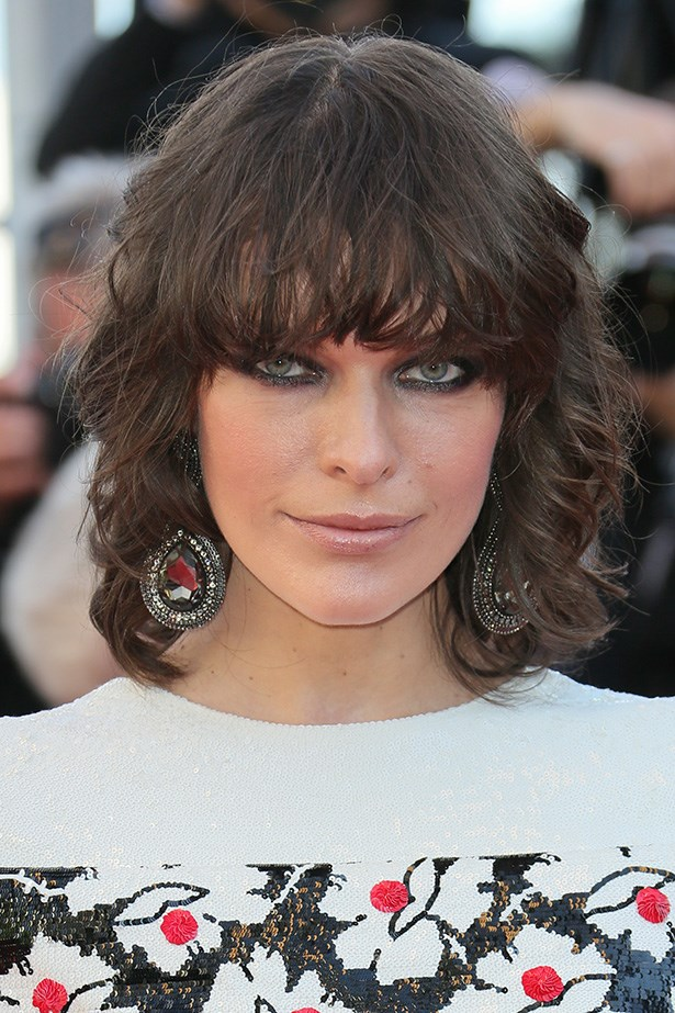 With a textured, wavy crop, Milla Jovovich coordinated her retro 'do with her large print gown at Premiere of <em>Blood Ties</em> during the 66th Annual Cannes Film Festival.