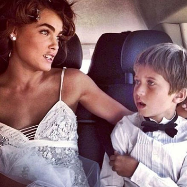 """<strong>@bambilegit</strong><br> """"EN ROUTE TO THE BIG DAY, WITH THE NUMBER ONE RING BOY,"""" posted the bride, wearing Roberto Cavalli, as she snuggled up to Single's son Justice on the way to the ceremony."""