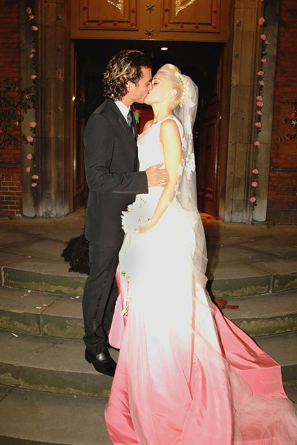 Gwen Stefani She started off in white up top, but then Gwen's custom John Galliano for Dior frock took an ombre pink twist in the skirt. Very fitting for this rock n rock bride who wed Gavin Rossdale in 2002.