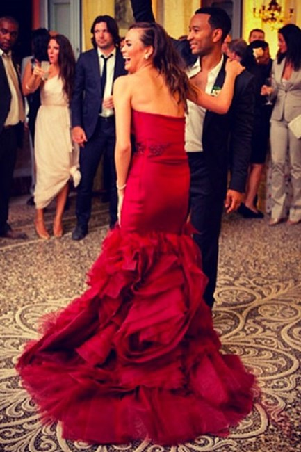 Chrissy Teigen While the model wore two white dresses for her 2013 wedding ceremony and reception to musician John Legend, she later changed into a third show-stopping, red Vera Wang gown for the after-party. Finish things off with a bang, we say.