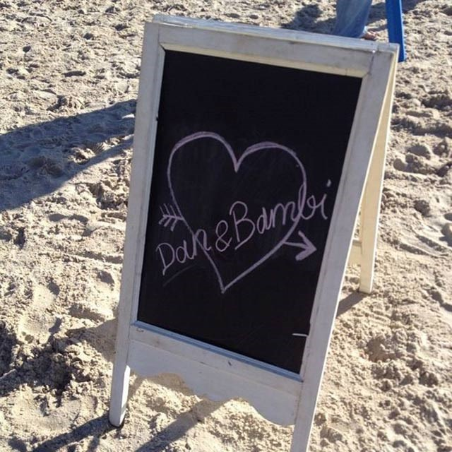 A cute chalkboard sign pointed guests towards the wedding spot.