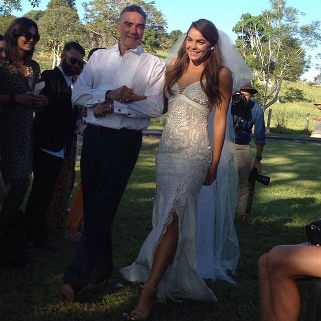 Here comes the bride: Northwood-Blyth couldn't wipe the smile off her face as she made her way down the aisle on her father's arm.
